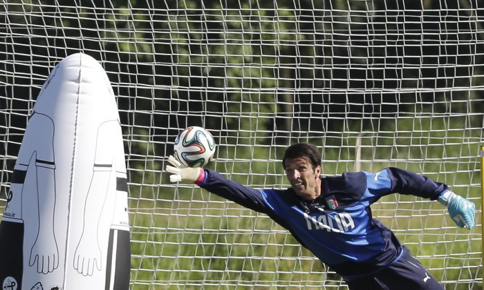 Italy's Gianluigi Buffon blocks the ball during a training session in Mangaratiba, Brazil, Tuesday, June 17, 2014. Italy plays in group D at the soccer World Cup. (AP Photo/Antonio Calanni)