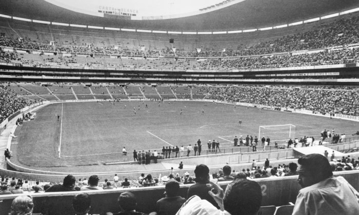 Soccer fans watch a match in progress 21 April 1970 at the Azteca stadium in Mexico City. The stadium with a capacity of 110.000 spectators was one of the venues for the World Cup. (STAFF/AFP/Getty Images)