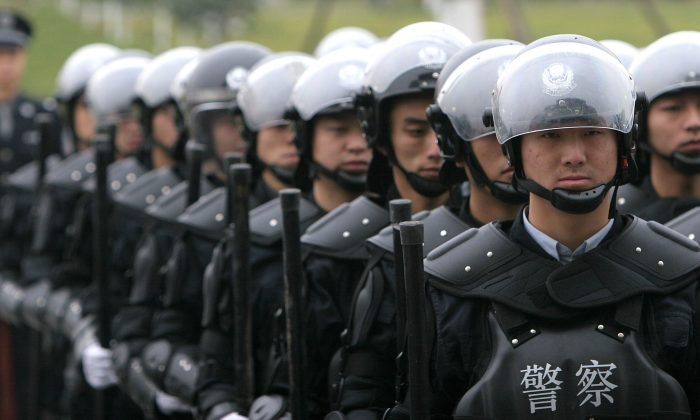 SWAT Team members in Chengdu, China, 2005. Over the last six months the Chinese regime has beefed up its security forces to face off against domestic unrest. (China Photos/Getty Images)