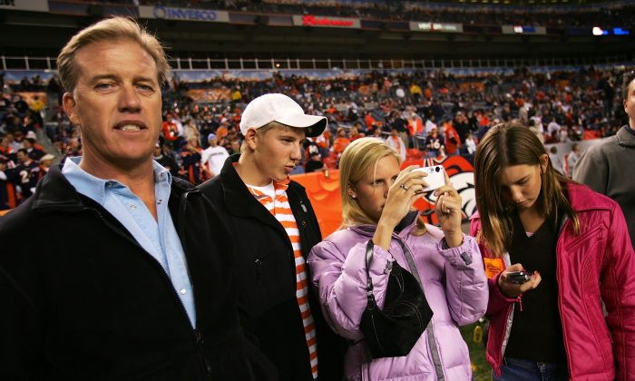 Jack Elway, second from left, and his father John Elway, left, with other family members in a 2006 file photo. (Doug Pensinger/Getty Images)