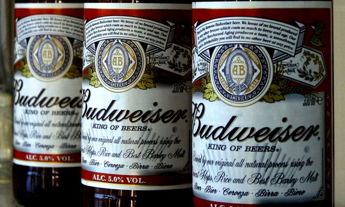 The legal drinking age hasn't been changed to 25 starting August 2014. This Jan. 27, 2009 file photo shows bottles of Budweiser beer are at the Stag Brewery in London. Anheuser-Busch unveiled the ingredients of Budweiser and Bud Light for the first time Thursday, June 12, 2014, a day after a popular food blogger started an online petition to get major brewers to list what's in their beverages. (AP Photo/Kirsty Wigglesworth, File)