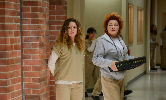 "This image released by Netflix shows Natasha Lyonne, left, and Kate Mulgrew in a scene from ""Orange is the New Black."" (AP Photo/Netflix, Ali Goldstein)"