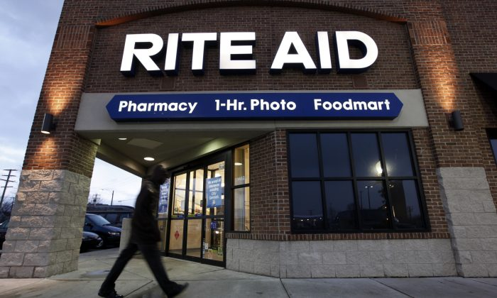 A number of stores and retailers Thanksgiving are closed, but stores like Rite Aid, Walgreens, and CVS are open. Starbucks and McDonald's are also open. FILE - In this Dec. 15, 2009 file photo, a customer enters a Rite Aid store in Detroit. Rite Aid reports quarterly financial results on Thursday, June 19, 2014. (AP Photo/Paul Sancya, File)