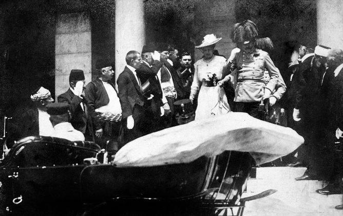 In this June 28, 1914, photo the Archduke of Austria Franz Ferdinand (C-R) and his wife Sophie walk to their a car in Sarajevo. This photo was taken minutes before the assassination of the Archduke and his wife, an event which set off a chain reaction of events which would eventually lead to World War I.