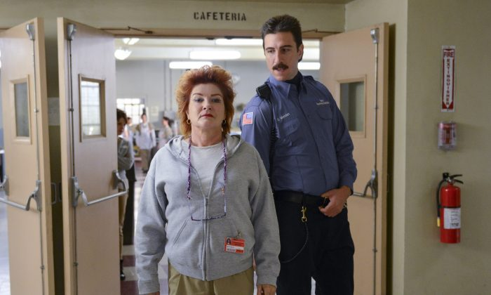 "This image released by Netflix shows Kate Mulgrew, left, and Pablo Schreiber in a scene from ""Orange is the New Black."" The second season of the prison series will be available on Friday, June 6, on Netflix. (AP Photo/Netflix, Ali Goldstein)"