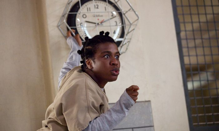 """This image released by Netflix shows Uzo Aduba in a scene from """"Orange is the New Black."""" The second season of the prison series will be available on Friday, June 6, on Netflix. (AP Photo/Netflix, Jessica Miglio)"""