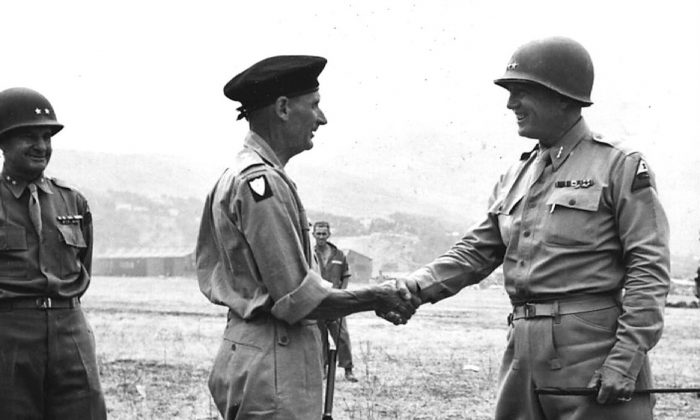 July 28, 1943, General George S. Patton bids farewell to British General Bernard Montgomery at a landing strip in Palermo, Italy. (US ARMY/AFP/Getty Images)