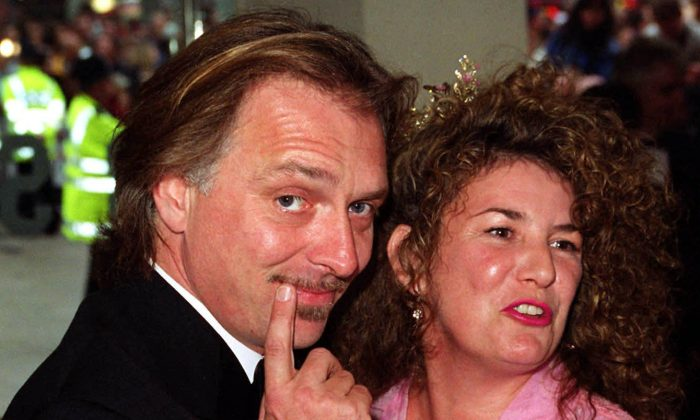 FiILE - This is a  May 31 2000 file photo of British comedian and actor Rik Mayall with his wife Barbara. Mayall, one of a generation of performers that injected post-punk energy into British comedy, has died. He was 56.  Mayall's management firm Brunskill Management said the comedian died early Monday June 9, 2014. (AP Photo/Peter Jordan/PA,File) UNITED KINGDOM OUT  PHOTOGRAPH CAN NOT BE STORED OR USED FOR MORE THAN 14 DAYS AFTER THE DAY OF TRANSMISSION