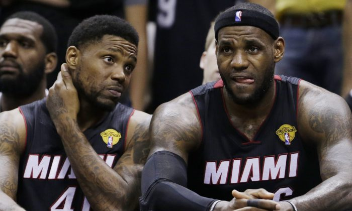 Miami Heat forward Udonis Haslem (40) and LeBron James (6) watch action against the San Antonio Spurs from the bench during the second half in Game 5 of the NBA basketball finals, on Sunday, June 15, 2014, in San Antonio. The Spurs won the NBA championship 104-87. (David J. Phillip)