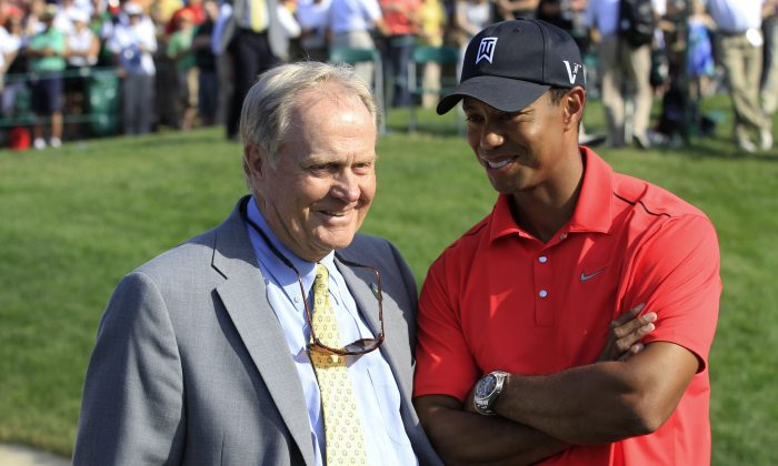 In this June 3, 2012, photo Jack Nicklaus (L) talks with Tiger Woods after Woods won the Memorial golf tournament at the Muirfield Village Golf Club in Dublin, Ohio. Nicklaus was in his customary spot behind the 18th green at Muirfield Village, waiting on the winner - or in this case, the survivor. Given the meltdowns by top players, this year without Tiger Woods has shown that it's really hard to win or that Woods was really good at it. (AP Photo/Tony Dejak)