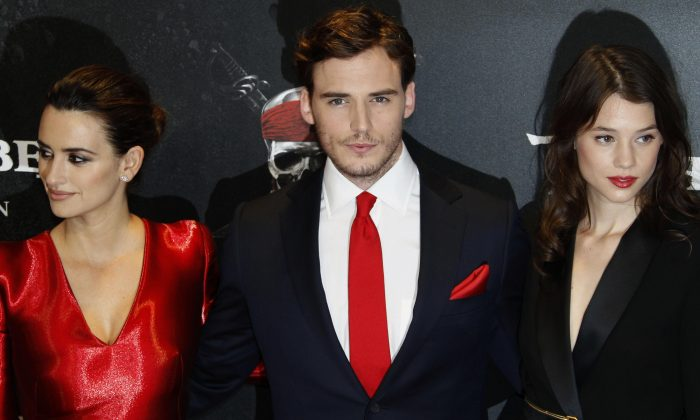 Actors Penelope Cruz, from left, Sam Claflin and Astrid Berges-Frisbey pose during a photocall on the red carpet for the German premiere of Pirates of the Caribbean: On Stranger Tides, southern Germany, on Monday, May 16, 2011. (AP Photo/Matthias Schrader)
