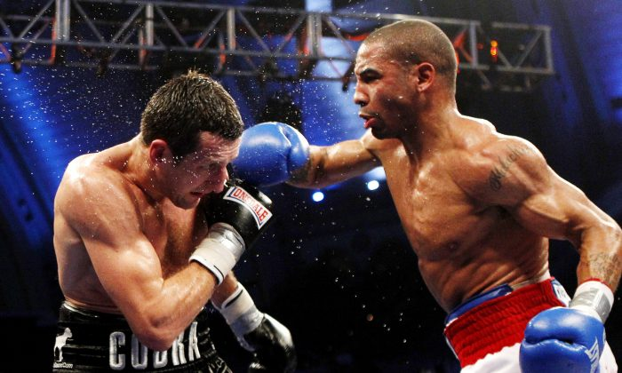 Andre Ward, right, connects with a right punch to the head of Carl Froch of England during a fight in New Jersey in 2011. Ward won in a unanimous decision, but a rematch could be Froch's next fight after the boxer defeated George Groves on May 31, 2014. (AP Photo/Rich Schultz)