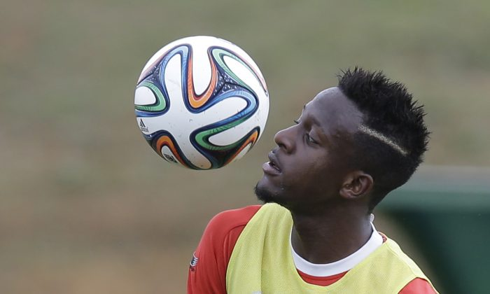 Belgium's Divock Origi controls the ball during a training session of Belgium in Mogi Das Cruzes, Brazil, Thursday, June 19, 2014. Belgium play in group H of the 2014 soccer World Cup. (AP Photo/Andrew Medichini)