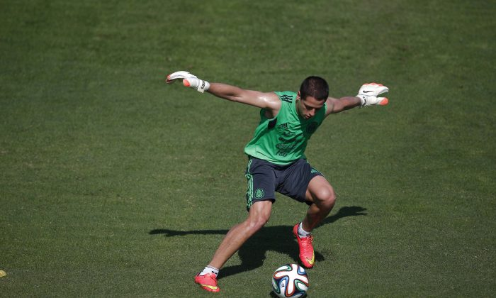 Mexico's national soccer team player Javier Hernandez fights for the ball during a training session in Santos, Brazil, Sunday, June 8, 2014. Mexico play in group A of the 2014 soccer World Cup. (AP Photo/Eduardo Verdugo)