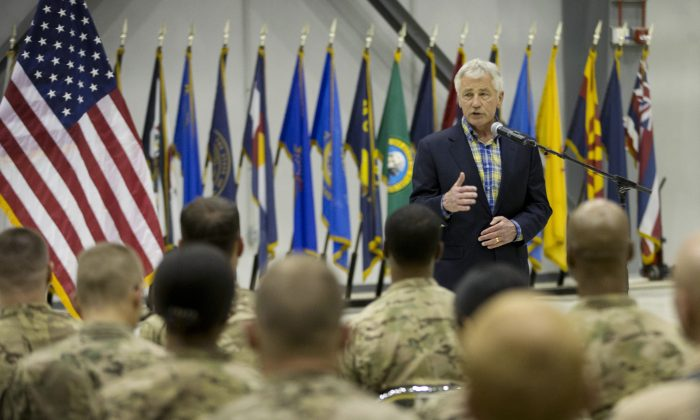 U.S. Defense Secretary Chuck Hagel speaks to members of the military during his visit to Bagram Airfield in Bagram, Afghanistan, on Sunday. (AP Photo/Pablo Martinez Monsivais, Pool)