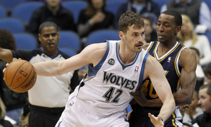 Minnesota Timberwolves forward Kevin Love (42) drives against Utah Jazz forward Jeremy Evans, right, during the first quarter of an NBA basketball game in Minneapolis, Wednesday, April 16, 2014. (AP Photo/Ann Heisenfelt)