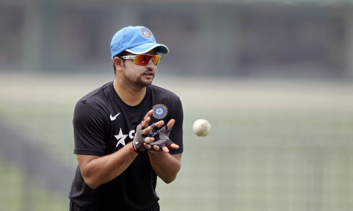 India's captain Suresh Raina takes a catch during a practice session ahead of the one-day series against Bangladesh in Dhaka, Bangladesh, Saturday, June 14, 2014. The three-match series will begin Sunday. (AP Photo/A.M. Ahad)