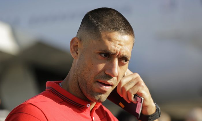 United States' national team soccer player Clint Dempsey arrives at the Sao Paulo International airport in Brazil, Monday, June 9, 2014. (AP Photo/Nelson Antoine)
