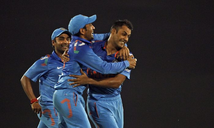 India's Stuart Binny, right, celebrates with teammates after the wicket of Bangladesh's Mahmudullah during their second one-day International cricket match in Dhaka, Bangladesh, Tuesday, June 17, 2014. (AP Photo/A.M. Ahad)