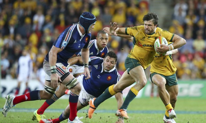 Australian Right Wing Adam Ashley-Cooper right, fends off French flanker Bernard le Roux during their Rugby test match in Brisbane, Australia, Saturday, June 7, 2014. (AP Photo/Tertius Pickard)