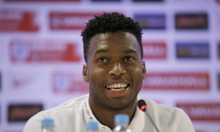 England national soccer team player Daniel Sturridge answers a question from a journalist during a press conference after a squad training session for the 2014 soccer World Cup at the Urca military base in Rio de Janeiro, Brazil, Monday, June 16, 2014.  (AP Photo/Matt Dunham)