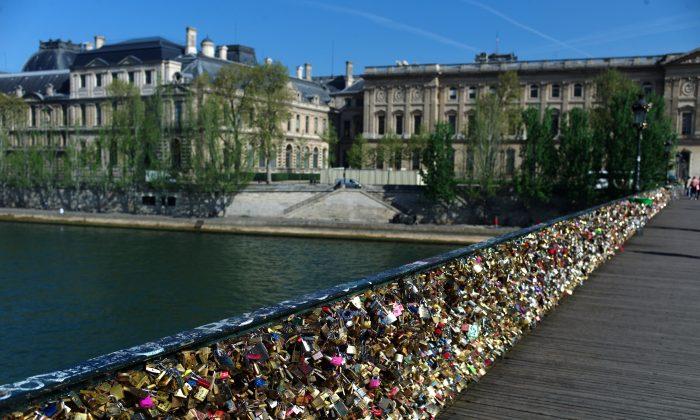 This April 9, 2014 photo shows love locks fixed on the Pont des Arts in Paris. (AP Photo/Thibault Camus)