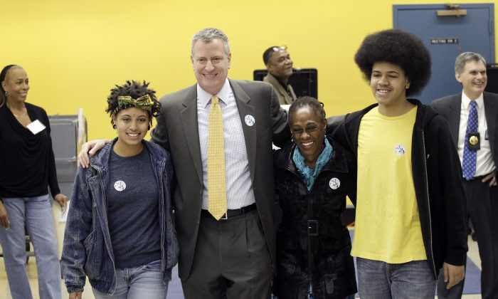 Bill de Blasio and his wife Chirlane McCray and children Dante (R) and Chiara (L) at a polling station in Park Slope, Brooklyn, Nov. 5, 2013. (Mark Lennihan/AP)