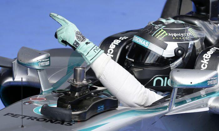 Mercedes driver Nico Rosberg of Germany celebrates winning the Austrian Formula One Grand Prix race at the Red Bull Ring in Spielberg, Austria, Sunday, June 22, 2014. (AP Photo/Darko Vojinovic)