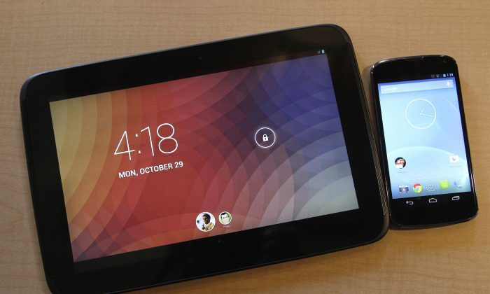 The Nexus 10 tablet, left, and the Nexus 4 smartphone are shown in a file photo.(AP Photo/Jeff Chiu)