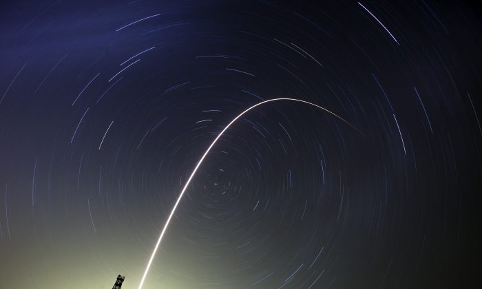 June 1: A long exposure of the Soyuz TMA-13M space ship carrying a new crew to the International Space Station, ISS, flies in the sky at the Russian leased Baikonur cosmodrome, Kazakhstan, on May 29, 2014.  (AP Photo/Dmitry Lovetsky)