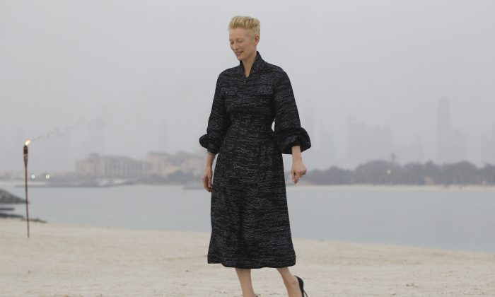 British actress Tilda Swinton arrives for the Chanel Cruise Dubai show revealing the French Maison's new Cruise collection of the 2014/15 season, staged on a private island in Dubai, United Arab Emirates, Tuesday, May 13, 2014. (AP Photo/Kamran Jebreili)