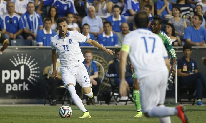 Greece's Andreas Samaris in action during an international friendly soccer match against Nigeria, Tuesday, June 3, 2014, in Chester, Pa. (AP Photo/Matt Slocum)