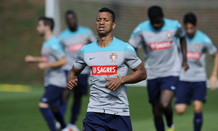 Nani practices during a training session of Portugal in Campinas, Brazil, Thursday, June 19, 2014. Portugal plays in group G of the Brazil 2014 soccer World Cup. (AP Photo/Paulo Duarte)