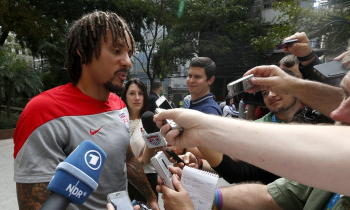 United States' Jermaine Jones talks to the media members in Sao Paulo, Brazil, Friday, June 13, 2014.  The U.S. will play in group G of the 2014 soccer World Cup. (AP Photo/Julio Cortez)