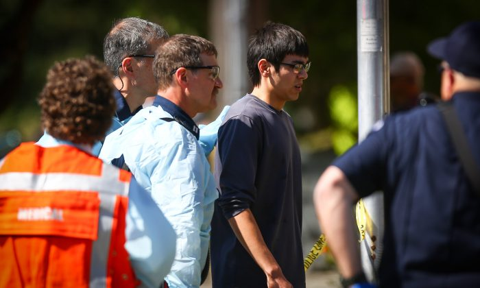 Jon Meis is taken from the scene by medics after a shooting at Seattle Pacific University on June 5. (AP Photo/seattlepi.com, Joshua Trujillo)