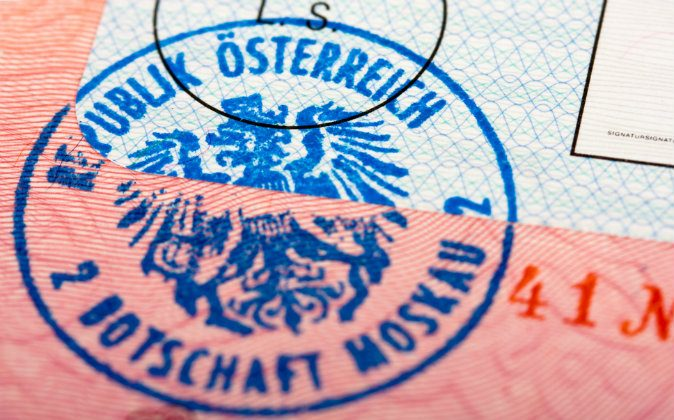 An Austrian passport stamp. A man who drove a Swiss car across the Austrian border got slapped with a hefty fine for violating a little-known law. (Shutterstock*)