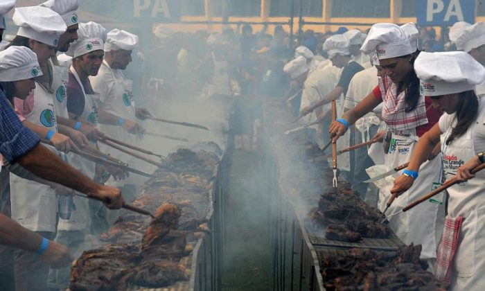 Cooks grill 26,400 pounds of beef during an event to break the Guinness record in Montevideo, Uruguay, on April 13, 2008. (Pablo Porciuncula/AFP/Getty Images)