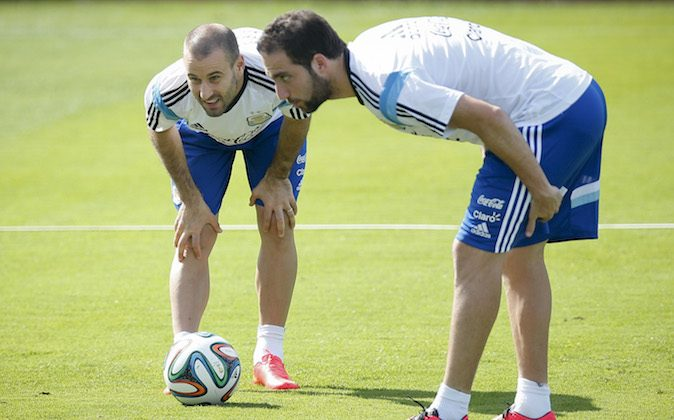 Argentina's Rodrigo Palacio, left, talks to teammate Gonzalo Higuain during a training session in Vespasiano, near Belo Horizonte, Brazil, Tuesday, June 17, 2014.  Argentina plays in group F of the 2014 soccer World Cup. (AP Photo/Victor R. Caivano)