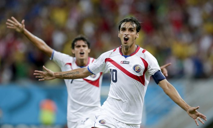 Costa Rica's Bryan Ruiz celebrates after scoring his side's first goal during the World Cup round of 16 soccer match between Costa Rica and Greece at the Arena Pernambuco in Recife, Brazil, Sunday, June 29, 2014. (AP Photo/Petr David Josek)