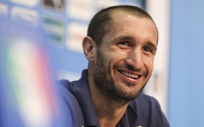 "Italy defender Giorgio Chiellini smiles during a press conference at the ""Casa Azzurri"" in Mangaratiba, Brazil, Saturday, June 7, 2014. Italy play in group D of the 2014 soccer World Cup. (AP Photo/Antonio Calanni)"