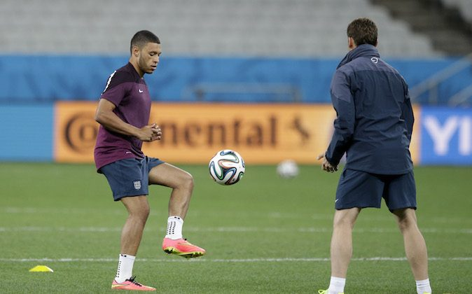 England national soccer player Alex Oxlade-Chamberlain, left, trains away from the rest of the squad whilst continuing to recover from a knee injury during a training session for the 2014 soccer World Cup at Itaquerao Stadium in Sao Paulo, Brazil, Wednesday, June 18, 2014.  Uruguay play England in group D of the 2014 soccer World Cup at the stadium on Thursday.  (AP Photo/Matt Dunham)