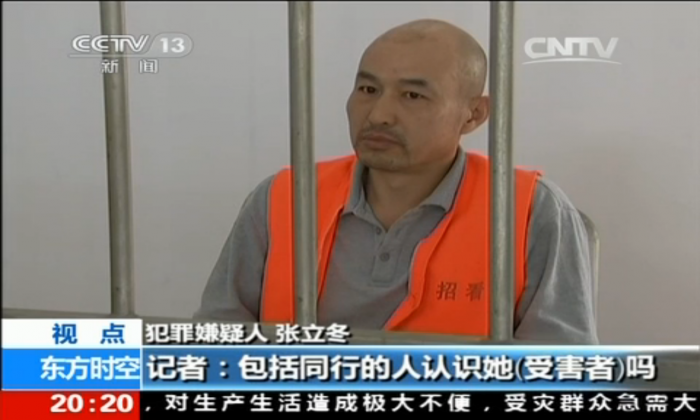Zhang Lidong, the leader of a gang that killed a young woman, is interviewed by the Chinese Central Television on May 31. Zhang and five others beat a woman to death in a McDonalds in Zhaoyuan City of Shandong Province on May 28. (Screenshot via CCTV)