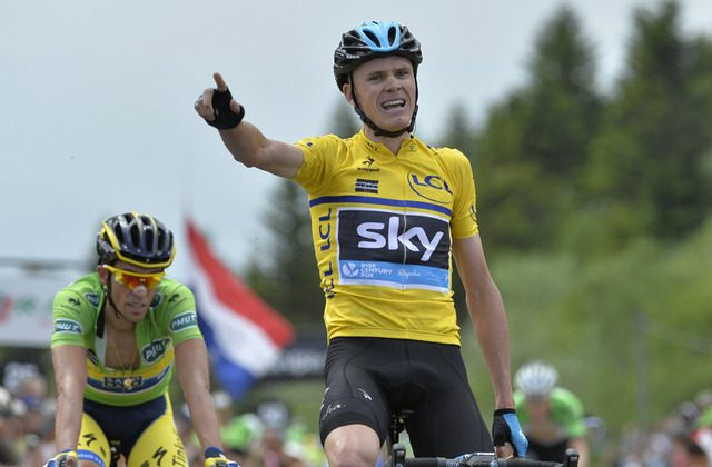 Sky's Chris Froome (C) tries to smile through his pain after beating Tinkoff's Alberto Contador (L) in Stage Two of the 2014 Critérium du Dauphiné between Tarare and Col du Beal, central France, on June 9, 2014. (teamsky.com)