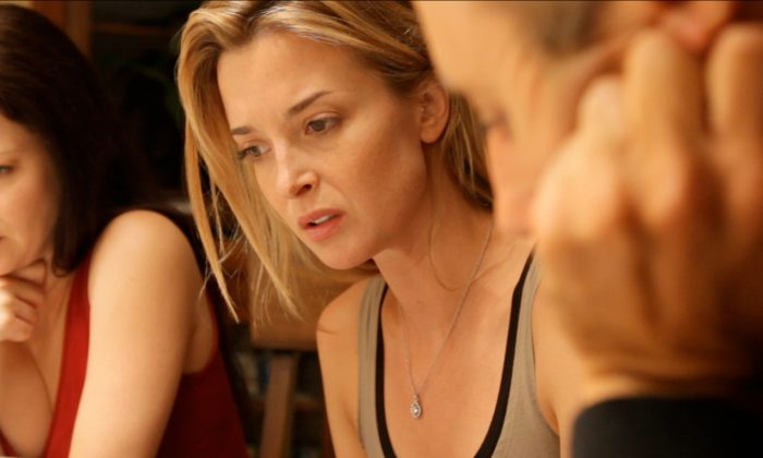 "Lauren Maher, Emily Baldoni, and Maury Sterling in a scene from the sci-fi thriller ""Coherence."" (Oscilloscope Laboratories)"