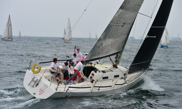 The crew of 'Talkinghead' were pleased with their performance finishing in first place in Race-2 of the IRC Division in the Helly Hansen Summer Saturday Series at Hebe Haven on Saturday June 14, 2014. (Bill Cox/Epoch Times)