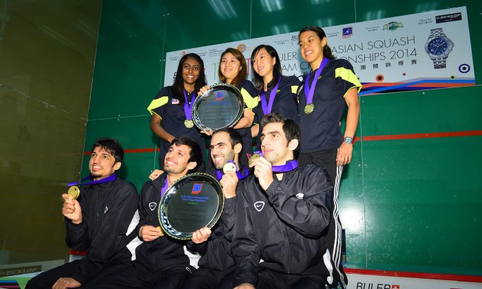 Malaysia women and Pakistan men Champions of the Buler Asian Team Squash Championship held at the Hong Hong Sqaush Centre from June 12 - 15, 2014. Top L to R: Vanessa Raj Gnanasigamani, Delia Arnold, Low Wee Wern and Nicol David. Bottom L to R: Farhan Zaman, Nazir Iqbal, Farhan Mehboob and Danish Atlas Khan. (Bill Cox/Epoch Times)