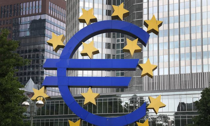 The logo of the European currency Euro is pictured in front of the European Central Bank ECB in Frankfurt am Main, Germany, May 26, 2014, a day after the European Parliament elections. (Daniel Roland/AFP/Getty Images)