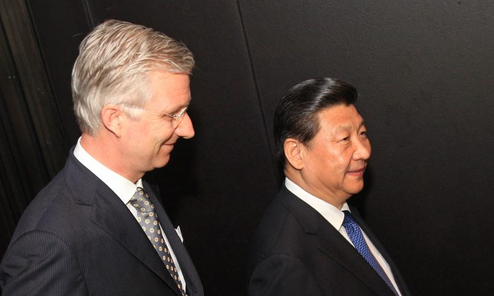 Belgium's King Philippe (L) and China's top leader Xi Jinping at the Concert building of Bruges on April 1, 2014, on the last leg of Xi's tour of Europe. (Yves Logghe/AFP/Getty Images)