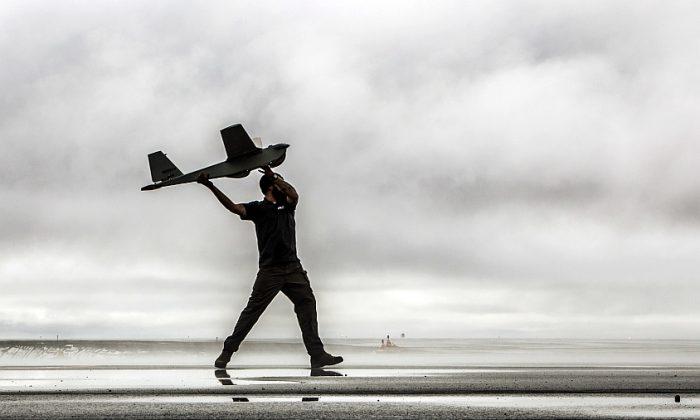 A man hand launches a Puma drone aircraft in an undated photo. (AP Photo/AeroVironment)