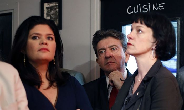 """French left-wing party """"Parti de Gauche"""" (PG) co-president Jean-Luc Melenchon (C) looks on next to PG candidates for the European elections Raquel Garrido (L) and Corinne Morel Darleux (R) after the announcement of the European Parliament elections results, on May 25, 2014. (Thomas Samson/AFP/Getty Images)"""